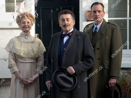 Stock Picture of British actor Robert Powell, centre, dressed as the character Poirot, poses at a photo call for Agatha Christie's first ever play, Black Coffee. Alongside Powell are actors Liza Goddard, as Miss Caroline Amory, and Robin McCallum, right, as Poirot's friend and confidante Captain Arthur Hastings. The photo call took place outside the former west London residence of author Christie, in Cresswell Place, London