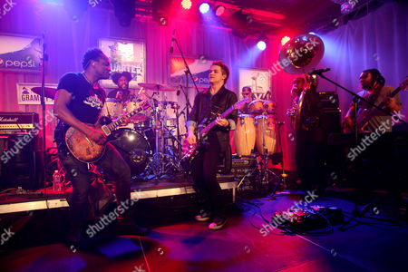 "Captain Kirk Douglas and ?uestlove of The Roots, Hunter Hayes, F. Knuckles, Damon ""Tuba Gooding Jr."" Bryson and Mark Kelley of The Roots perform at the Pepsi 5th Quarter in the French Quarter Post Super Bowl Party,, in New Orleans"