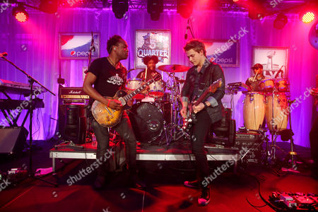 Captain Kirk Douglas and ?uestlove of The Roots, Hunter Hayes and F. Knuckles of The Roots perform at the Pepsi 5th Quarter in the French Quarter Post Super Bowl Party,, in New Orleans