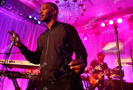 Jamie Foxx and Captain Kirk Douglas of The Roots perform at the Pepsi 5th Quarter in the French Quarter Post Super Bowl Party,, in New Orleans