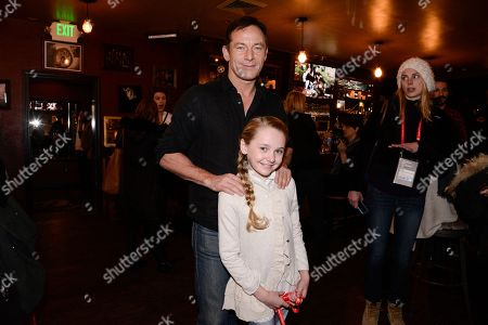 Actor Jason Isaacs, left, and actress Avery Phillips seen at The Hollywood Reporter Studio at Sundance on in Park City, Utah