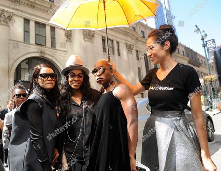 Teyana Taylor, June Ambrose and Cynthia Erivo are shaded from the hot summer sun by AccuWeather's MinuteCast umbrellas at New York Fashion Week, in New York. The AccuWeather MinuteCast Street Team is at it again helping Fashion Week attendees stay stylish and one-step ahead of any possible precipitation