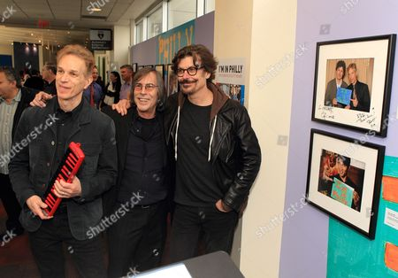 Celebrity photographer Scott Weiner (center) with Rob Hyman (left) and Eric Bazilian of the rock and The Hooters attend the exhibition opening I'm In Philly at the Philadelphia International Airport, in Philadelphia