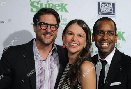 The stars of Shrek The Musical, Christopher Sieber, Sutton Foster and Daniel Breaker, left to right, strike a pose on the green carpet to celebrate the Blu-ray and DVD release, in New York