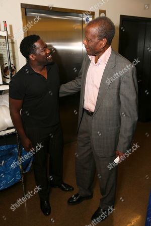 "From left, writer/cast member Daniel Beaty and actor Sidney Poitier talk backstage after the performance of ""The Tallest Tree in the Forest"" at the Center Theatre Group/Mark Taper Forum, in Los Angeles, Calif"