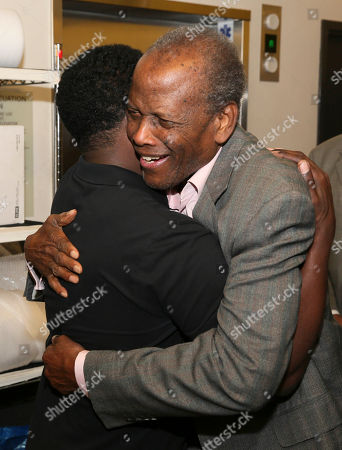 "From left, writer/cast member Daniel Beaty is hugged by actor Sidney Poitier backstage after the performance of ""The Tallest Tree in the Forest"" at the Center Theatre Group/Mark Taper Forum, in Los Angeles, Calif"