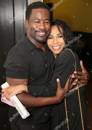 "From left, writer/cast member Daniel Beaty and actress Khandi Alexander pose backstage after the performance of ""The Tallest Tree in the Forest"" at the Center Theatre Group/Mark Taper Forum, in Los Angeles, Calif"