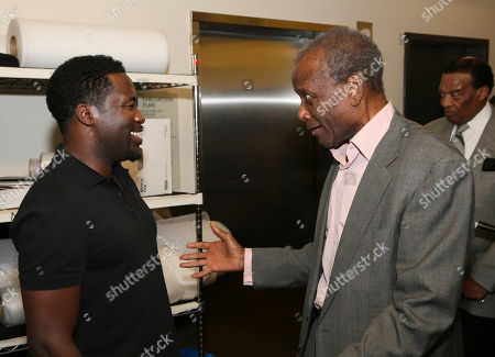 "From left, writer/cast member Daniel Beaty is congratulated by actor Sidney Poitier backstage after the performance of ""The Tallest Tree in the Forest"" at the Center Theatre Group/Mark Taper Forum, in Los Angeles, Calif"