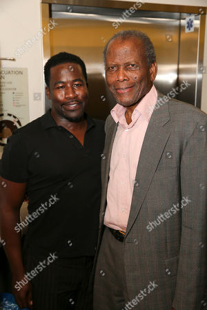"From left, writer/cast member Daniel Beaty and actor Sidney Poitier pose backstage after the performance of ""The Tallest Tree in the Forest"" at the Center Theatre Group/Mark Taper Forum, in Los Angeles, Calif"