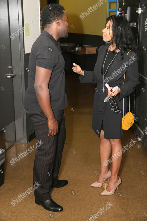 "From left, writer/cast member Daniel Beaty and actress Khandi Alexander talk backstage after the performance of ""The Tallest Tree in the Forest"" at the Center Theatre Group/Mark Taper Forum, in Los Angeles, Calif"