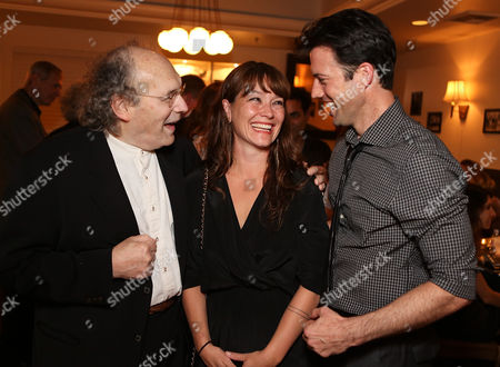 """From left, Larry Pisoni, co-founder/clown Pickle Family Circus, co-creator/director Erica Schmidt and co-creator/performer Lorenzo Pisoni celebrate during the party for the opening night performance of """"Humor Abuse"""" at the Center Theatre Group/Mark Taper Forum, in Los Angeles, Calif"""