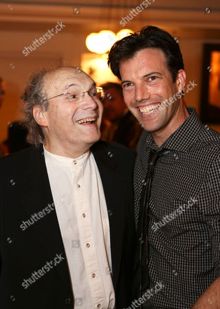 """From right, co-creator/performer Lorenzo Pisoni and father Larry Pisoni, co-founder/clown Pickle Family Circus pose during the party for the opening night performance of """"Humor Abuse"""" at the Center Theatre Group/Mark Taper Forum, in Los Angeles, Calif"""
