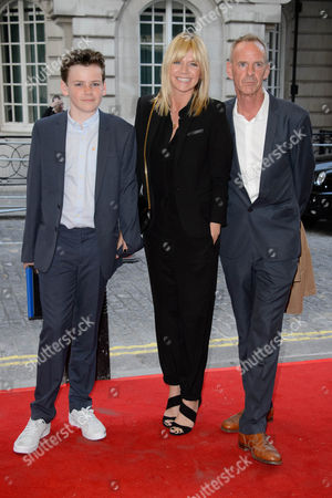 British personality Zoe Ball, centre, British musician Norman Cook, right and their son Woody Cook, left pose for photographers upon arrival for the UK Gala screening of Man Up at a central London cinema