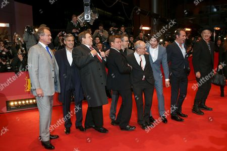 From left, actors Hugh Bonneville, George Clooney, John Goodman, Justus von Dohnanyi, Matt Damon, Ben Balaban, Dimitri Leonidas, Jean Dujardin and Bill Murray arrive on the red carpet for the film The Monuments Men during the 64th Berlinale International Film Festival, in Berlin