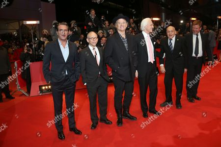 From left, actors Jean Dujardin, Ben Balaban and Bill Murray, writer Robert M. Edsel, Harry Ettlinger and actor Justus von Dohnanyi arrive on the red carpet for the film The Monuments Men during the 64th Berlinale International Film Festival, in Berlin