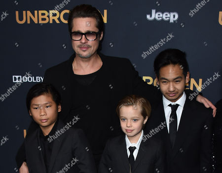 """Stock Photo of Brad Pitt, center, Pax Thien Jolie-Pitt, Shiloh Jolie-Pitt and Maddox Jolie-Pitt arrive at the LA premiere of """"Unbroken"""" on in Los Angeles"""