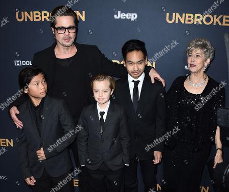 """Brad Pitt, center, Pax Thien Jolie-Pitt, Shiloh Jolie-Pitt and Maddox Jolie-Pitt arrive at the LA premiere of """"Unbroken"""" on in Los Angeles"""