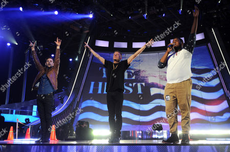 From left, Ryan Lewis, Macklemore and Ray Dalton rehearse for the MTV Movie Awards at Sony Pictures Studios, in Culver City, Calif