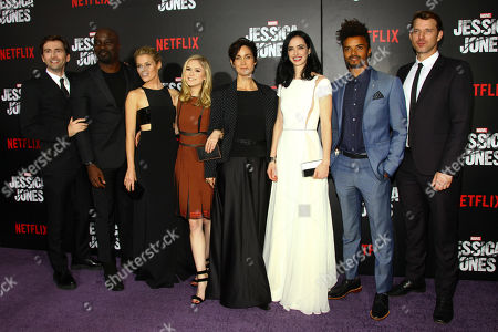 """David Tennant, from left, Mike Colter, Rachael Taylor, Erin Moriarty, Carrie-Anne Moss, Krysten Ritter, Eka Darville and Wil Traval attend the Netflix original series premiere of """"Marvel's Jessica Jones"""" at the Regal E-Walk, in New York"""