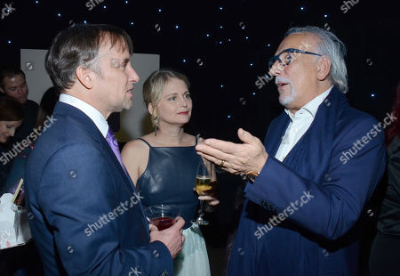Richard Linklater, from left, Cathleen Sutherland, and Roberto Coin attend The Hollywood Reporter Nominees Night presented by Cadillac, with Delta, Roberto Coin, and Neiman Marcus Beverly Hills at Spago on Mon., in Beverly Hills, Calif