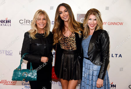 Lisa Gastineau, left, Courtney Sixx, center, and Kimberly Dawn pose together at the Third Annual All Star Mixology Competition at SKYBAR at Mondrian, in West Hollywood, Calif