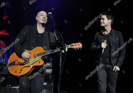 Jimmy Stafford, left, and Pat Monahan, right, perform with Train at Radio City Music Hall on in New York