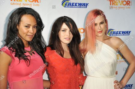 From left, Corbin Reid, Lindsay Pearce and Rumer Willis arrive at the Trevor Project Prom held at the Petersen Automotive Museum on in Los Angeles