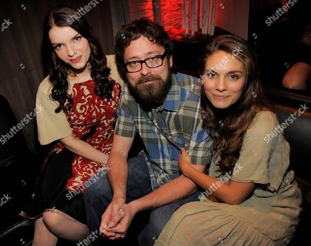 "All Cheerleaders Die"" co-writer and co-director Lucky McKee, center, poses with cast members Sianoa Smit-McPhee, left, and Caitlin Stasey during a party for the film on day one of the 2013 Toronto International Film Festival at Brassaii on in Toronto"