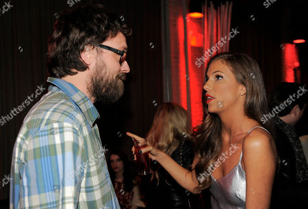"""Lucky McKee, left, co-writer and co-director of """"All Cheerleaders Die,"""" mingles with cast member Reanin Johannink during a party for the film on day one of the 2013 Toronto International Film Festival at Brassaii on in Toronto"""