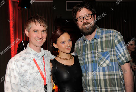 """All Cheerleaders Die"""" co-directors and co-writers Chris Sivertson, left, and Lucky McKee, right, pose with cast member Amanda Grace Cooper on day one of the 2013 Toronto International Film Festival at Brassaii on in Toronto"""