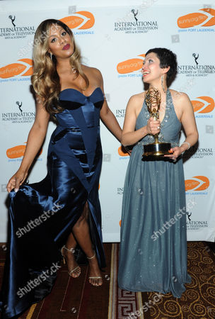 Stock Photo of Laverne Cox, left, poses with Swedish director Maryam Ebrahimi, winner of the Documentary Award, at the 42ndAnnual International Emmy Awards, held at the New York Hilton. This is the fourth year the Greater Fort Lauderdale Convention & Visitors Bureau has partnered with the International Emmy Awards to highlight Greater Fort Lauderdale as an ideal location for film, music, arts and culture