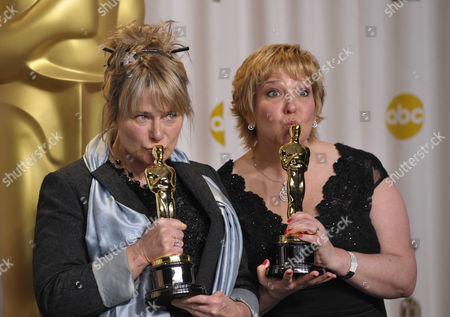 "Stock Image of SCIENCES FOR USE UPON CONCLUSION OF THE ACADEMY AWARDS TELECAST ** Julie Dartnell, left, and Lisa Westcott pose with their award for best makeup and hairstyling for ""Les Miserables"" during at the Oscars at the Dolby Theatre, in Los Angeles"