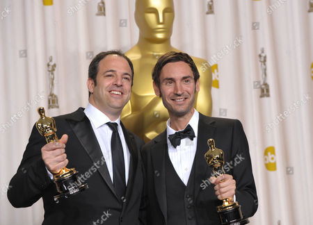 """SCIENCES FOR USE UPON CONCLUSION OF THE ACADEMY AWARDS TELECAST ** Producer Simon Chinn, left, and actor Malik Bendjelloul pose with their award for best documentary feature for """"Searching for Sugar Man"""" during the Oscars at the Dolby Theatre, in Los Angeles"""