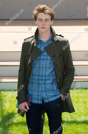 George McKay arrives for the Burberry Prorsum Menswear collection during London Collections for Men Spring/Summer 2015 in central London, London