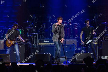 Chris Henderson, left, Brad Arnold, and Justin Biltonen of 3 Doors Down perform at Charlie Daniels 80th Birthday Volunteer Jam at Bridgestone Arena on Wednesday, Nov, 30, 2016, in Nashville, Tenn