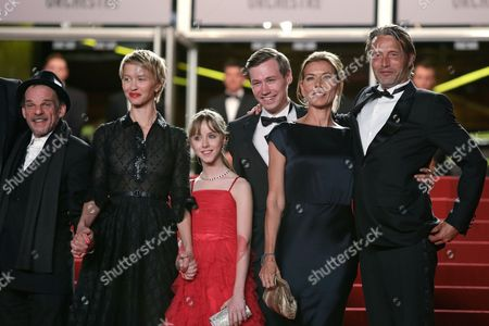 From left, actors Denis Lavant, Delphine Chuillot, Melusine Mayance, David Kross, Mads Mikkelsen's wife Hanne Jacobsen and actor Mads Mikkelsen arrive for the screening of the film Michael Kohlhaas at the 66th international film festival, in Cannes, southern France