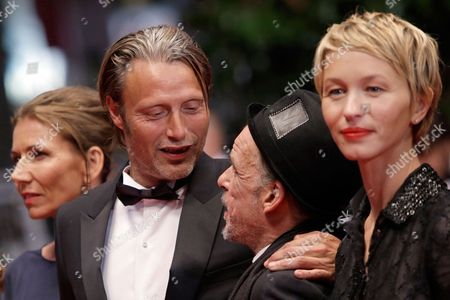 From left, actor Mads Mikkelsen's wife Hanne Jacobsen, actors Mads Mikkelsen, Denis Lavant and Delphine Chuillot arrive for the screening of Michael Kohlhaas at the 66th international film festival, in Cannes, southern France