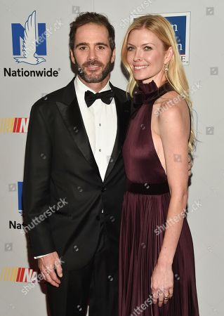 Stock Picture of NASCAR Driver Jimmie Johnson and Chandra Janway attends the NASCAR Foundation's inaugural honors gala at the Marriott Marquis, in New York