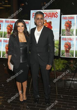 """Actress Eva Longoria and director Sanjay Rawal attend the premiere of """"Food Chains"""" on Tuesday, Nov.18, 2014, at the The Food Foundation in New York"""