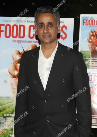 """Director Sanjay Rawal attends the premiere of """"Food Chains"""" on Tuesday, Nov.18, 2014, at the The Food Foundation in New York"""