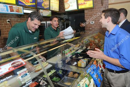 SUBWAY Famous Fans Mike Golic, left, and Mike Greenberg, center, of ESPN, test fans' knowledge of football themed trivia questions at a SUBWAY restaurant in New York, as part of the FOOTLONGS and Football ANYone? event celebrating SUBtember, where any regular footlong sandwich is $5 all month long