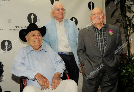 "Jonathan Winters, left, Stan Freberg, center, and Mickey Rooney, cast members in the 1963 film ""It's a Mad, Mad, Mad, Mad World,"" pose together at the kick-off of The Last 70mm Film Festival Presented by the Academy of Motion Picture Arts and Sciences, at the Samuel Goldwyn Theater in Beverly Hills, Calif"
