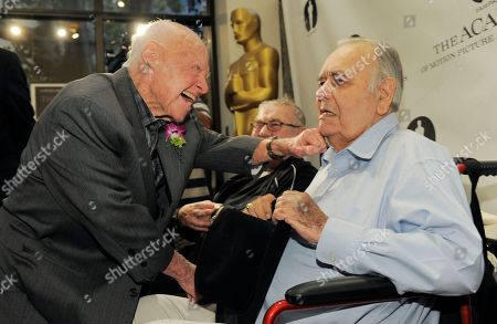 "Mickey Rooney, left, a cast member in the 1963 film ""It's a Mad, Mad, Mad, Mad World,"" mugs with fellow cast member Jonathan Winters at the kick-off of The Last 70mm Film Festival Presented by the Academy of Motion Picture Arts and Sciences, at the Samuel Goldwyn Theater in Beverly Hills, Calif"