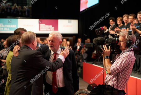 Jeremy Corbyn embraces John Prescott as he arrives to begin the Leader's Speech at the Labour Party Conference, Brighton, UK.