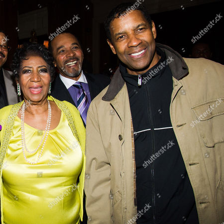 Aretha Franklin and Denzel Washington with Clifton Oliver, rear, attend her 72nd birthday celebration on in New York