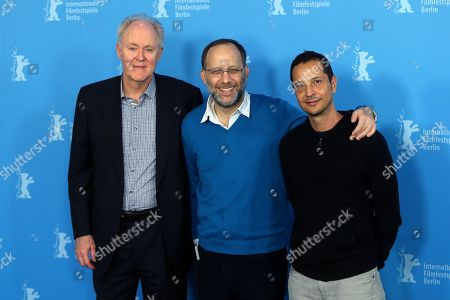 From left, actor John Lithgow, director Ira Sachs and producer Mauricio Zacharias pose for photographers at the photo call for the film Love Is Strange during the 64th Berlinale International Film Festival,, in Berlin
