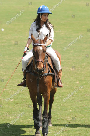 West Palm Beach Fl - March 14: Kourtney Kardashian and Scott Disick with Their Young Son Mason Dash Disick in Tow Take a Polo Lesson with Top Ranked American Polo Player Nic Roldan the Couple Was Joined by Sister Khloe Kardashian the Kardashian Clan Had a Great Afternoon Riding Horses and Joking Around While They Sipped Champagne at the International Polo Club Palm Beach On March 14 2010 in Wellington Florida People: Kourtney Kardashian