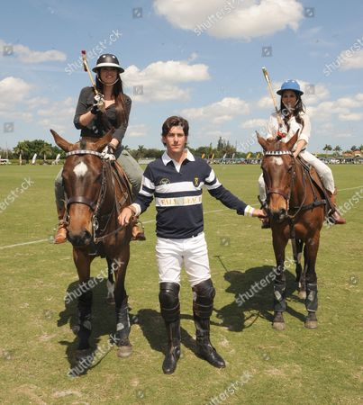 Stock Photo of West Palm Beach Fl - March 14: Kourtney Kardashian and Scott Disick with Their Young Son Mason Dash Disick in Tow Take a Polo Lesson with Top Ranked American Polo Player Nic Roldan the Couple Was Joined by Sister Khloe Kardashian the Kardashian Clan Had a Great Afternoon Riding Horses and Joking Around While They Sipped Champagne at the International Polo Club Palm Beach On March 14 2010 in Wellington Florida People: Khloe Kardashian_nic Roldan_kourtney Kardashian