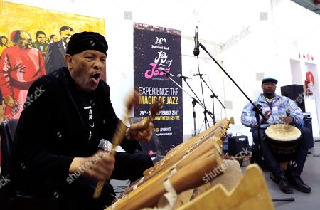 "Stock Photo of Jazz musician Roy Ayers, left, plays an African Marimba instrument during his workshop with young music artist at Funda Centre in Soweto, South Africa, . Ayers, who is in South Africa for a jazz festival, radiated enthusiasm on Friday as he urged a couple of dozen people at an arts center to ""vibe on"" role models even if they don't always meet expectations"