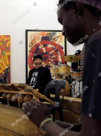 "Jazz musician Roy Ayers, background plays an African Marimba instrument during his workshop with young music artist at Funda Centre in Soweto, South Africa, . Ayers, who is in South Africa for a jazz festival, radiated enthusiasm on Friday as he urged a couple of dozen people at an arts center to ""vibe on"" role models even if they don't always meet expectations"